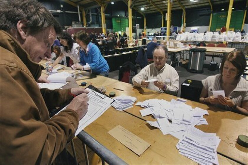 """A tallyman, left, watches as counting of votes begins for the European Union's reform treaty at the RDS Election Count Center, in Dublin, Ireland Saturday Oct. 3, 2009. Irish Prime Minister Brian Cowen is seeking a strong """"yes'' vote in Friday's referendum for the Lisbon Treaty, which proposes a wide range of reforms for the 27-nation bloc. All the other nations already back the treaty but Ireland's voters rejected it in an initial referendum last year. (AP Photo/Niall Carson/PA Wire)"""