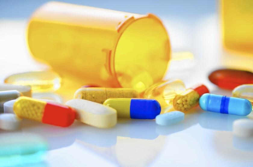 Photo illustration of pills and a prescription bottle