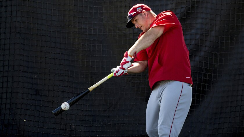 Angels center fielder Mike Trout takes batting practice during a spring training workout on Feb. 28.