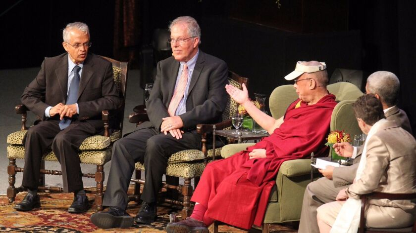 The Dalai Lama discusses climate change with scientists Veerabhadran Ramanathan (far left), and Richard Somerville at UC San Diego in 2012.