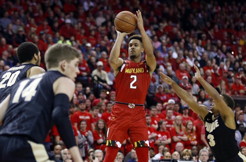 FILE - In this Feb. 6, 2015, file photo, Maryland guard Melo Trimble, center, shoots over Purdue center A.J. Hammons (20), guard Ryan Cline (14) and guard P.J. Thompson in the second half of an NCAA college basketball game, in College Park, Md. Tenth-ranked Maryland has sputtered lately, yet remains in the running for the Big Ten title with three games to go - a pivotal stretch that begins Saturday, Feb. 27, at Purdue. (AP Photo/Patrick Semansky, File)
