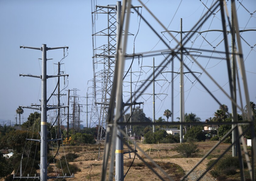 Power lines run through the Clairemont neighborhood of San Diego. The city of San Diego has invited seven cities and unincorporated areas of the county to join forces and create a community choice energy program that would offer an alternative to San Diego Gas & Electric.