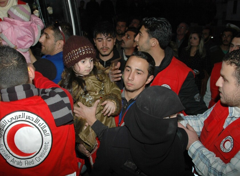 Syrians evacuated in city of Homs