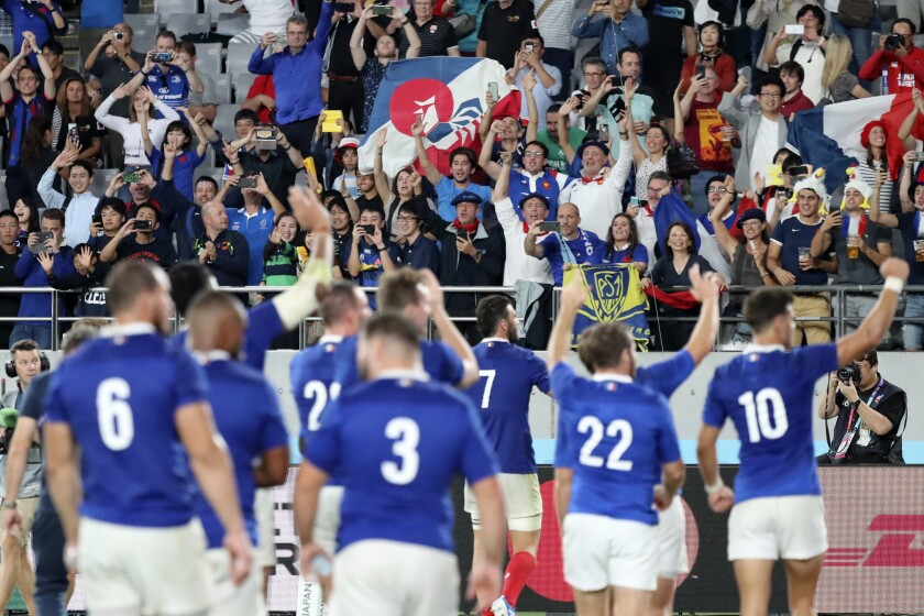 Fans for France team cheer after the Rugby World Cup Pool C game at Tokyo Stadium between France and Argentina in Tokyo, Japan, Saturday, Sept. 21, 2019. (AP Photo/Eugene Hoshiko)
