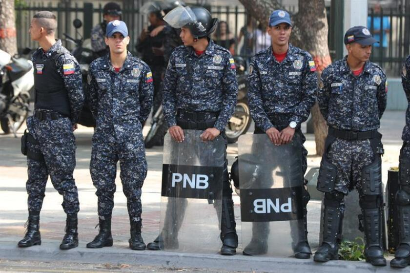 Venezuela's Bolivarian National Police deploy in Caracas on March 19, 2019, to prevent opposition supporters from staging a march to the seat of the opposition-controlled Parliament. EFE-EPA/ Raul Martinez
