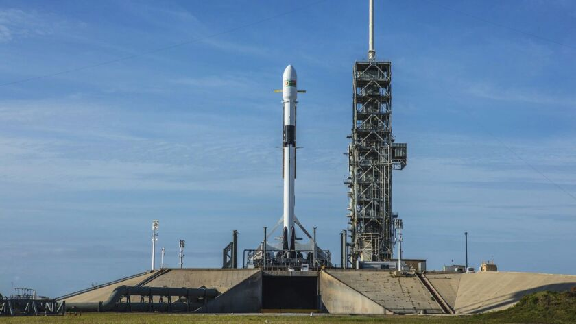 This photo provided by SpaceX shows a Falcon 9 at Kennedy Space Center in Cape Canaveral, Fla., Thur