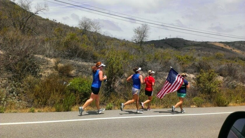Military wives in Camp Pendleton's Stroller Warrior's  running club participate in a race on base.