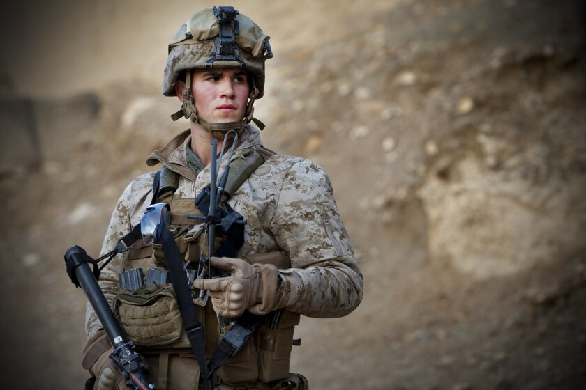 Cpl. Jason Gaal, who was promoted to squad leader after another Marine he admired died, keeps a watch on his squad as he leads them on an overnight combat patrol in Afghanistan in March, 2011.