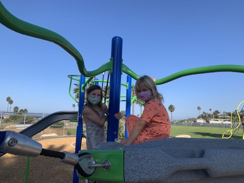 Cardiff School children enjoying the new playground equipment.