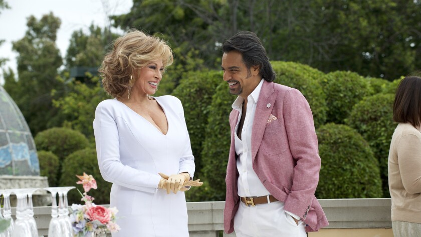 """Raquel Welch and Eugenio Derbez in the movie """"How to Be a Latin Lover."""""""