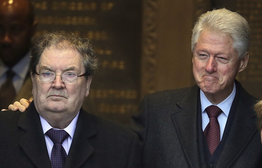 Former US President Bill Clinton with John Hume at the Guildhall in Londonderry, Northern Ireland in 2014.