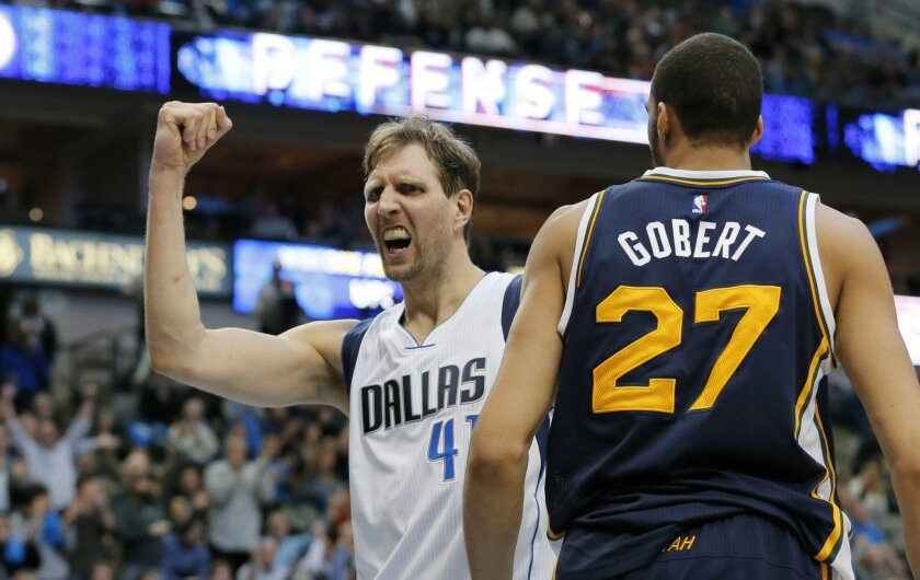 FILE - In this Feb. 9, 2016, file photo, Dallas Mavericks' Dirk Nowitzki (41) of Germany celebrates a basket in front of Utah Jazz's Rudy Gobert (27) of France, in the second half of an NBA basketball game, in Dallas. Nowitzki and the Mavericks probably aren't going far assuming they make the playo