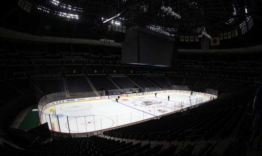 Colorado Avalanche players take part in drills during the team's practice in an empty Pepsi Center on Monday in Denver.