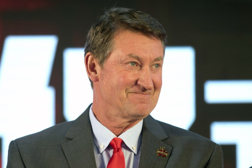FILE - Former NHL hockey player Wayne Gretzky smiles during a promotional event for the Beijing Kunlun Red Star hockey team in Beijing, in this Thursday, Sept. 13, 2018, file photo. Alex Ovechkin starts a new five-year contract ready to chase Gretzky's career goals record that long seemed unbreakable. The Washington Capitals captain has 730 goals and needs 165 to pass Gretzky. (AP Photo/Mark Schiefelbein, File)