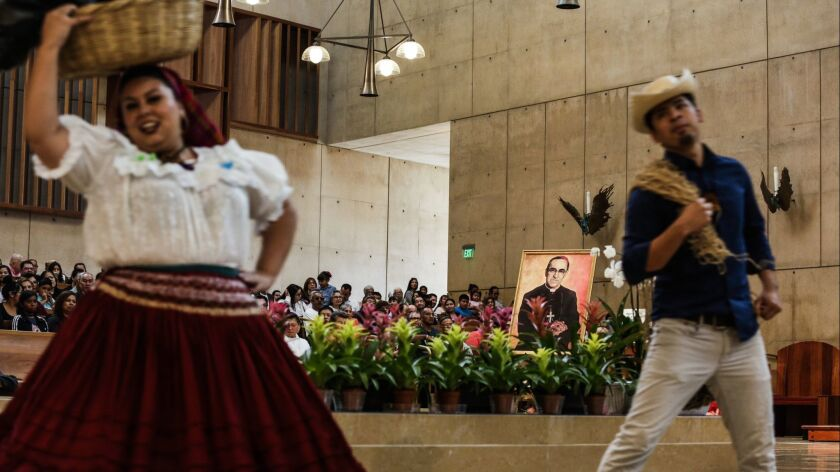 Folkloric dancers celebrate the canonization of Salvadoran Archbishop Oscar Romero on Sunday at the Cathedral of Our Lady of the Angels in downtown Los Angeles.