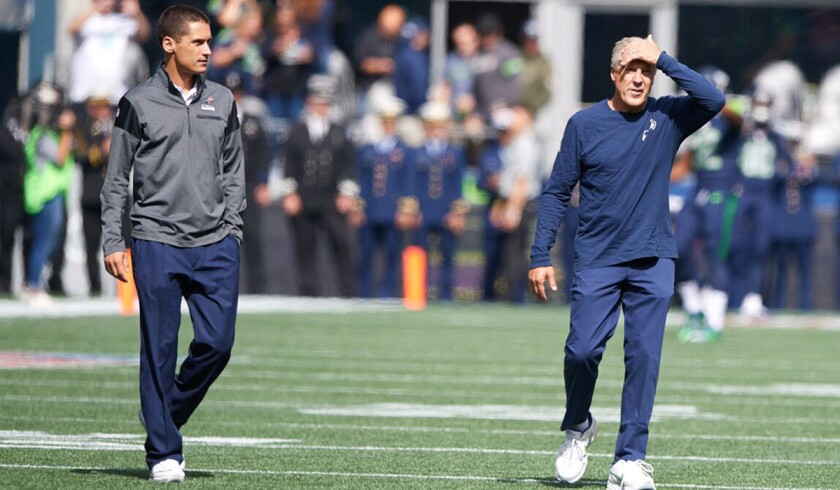 Ben Malcolmson, left, with Pete Carroll. Malcolmson is Carroll's special assistant. The relationship started at USC.