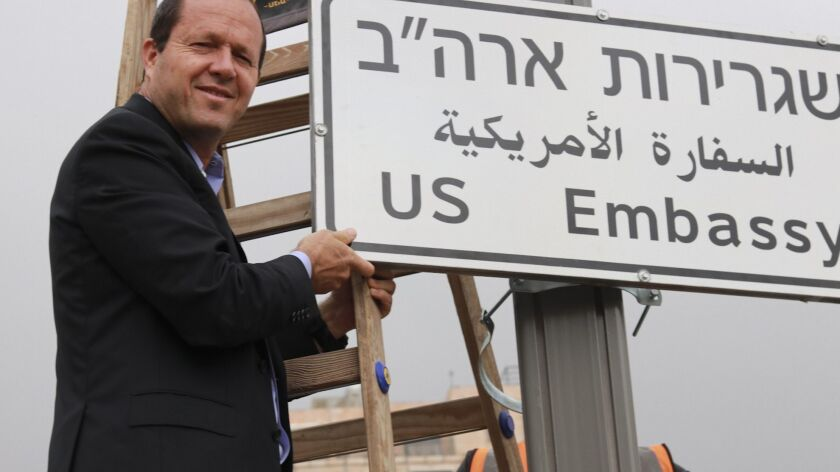 In this photo released by the Jerusalem Municipality, Jerusalem mayor Nir Barkat poses with a new ro