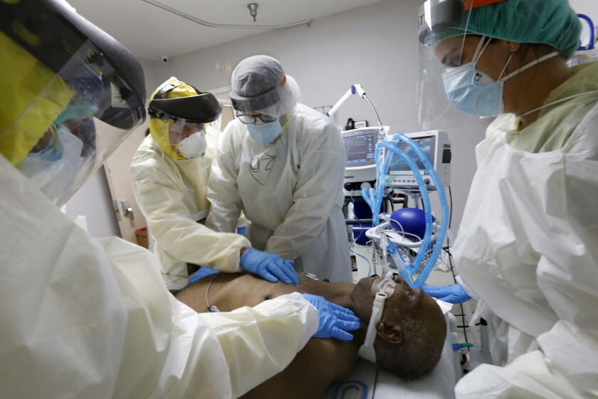 A team at United Memorial Medical Center in Houston attempts to resuscitate a COVID-19 patient.