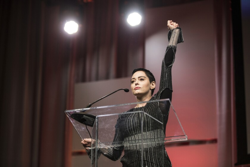 Rose McGowan raises her fist as she speaks during the Women's Convention at Cobo Center in downtown Detroit on Oct. 27, 2017.