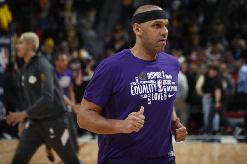 Lakers forward Jared Dudley warms up before a game against the Nuggets on Feb. 12, 2020, in Denver.