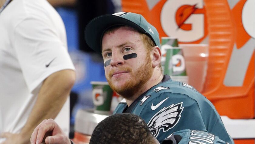 Philadelphia Eagles' Carson Wentz and Darren Sproles (43) sit on the sideline during the first half
