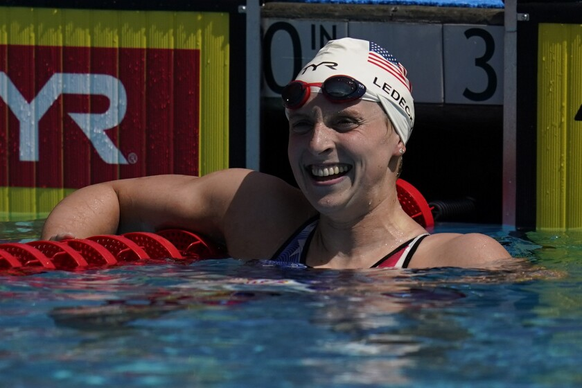 Katie Ledecky looks at the results in the women's 400-meter freestyle final at the TYR Pro Swim Series swim meet Saturday, April 10, 2021, in Mission Viejo, Calif. Ledecky finished first. (AP Photo/Ashley Landis)