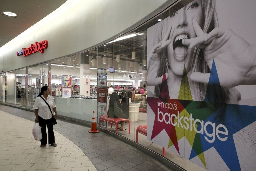 In this Wednesday, Aug. 26, 2015 photo, a shopper walks past the Macy's Backstage store in the Queens borough of New York. Macy's decision to jump into the off-price game comes as the department store retailer faces a sales slowdown. (AP Photo/Mary Altaffer)