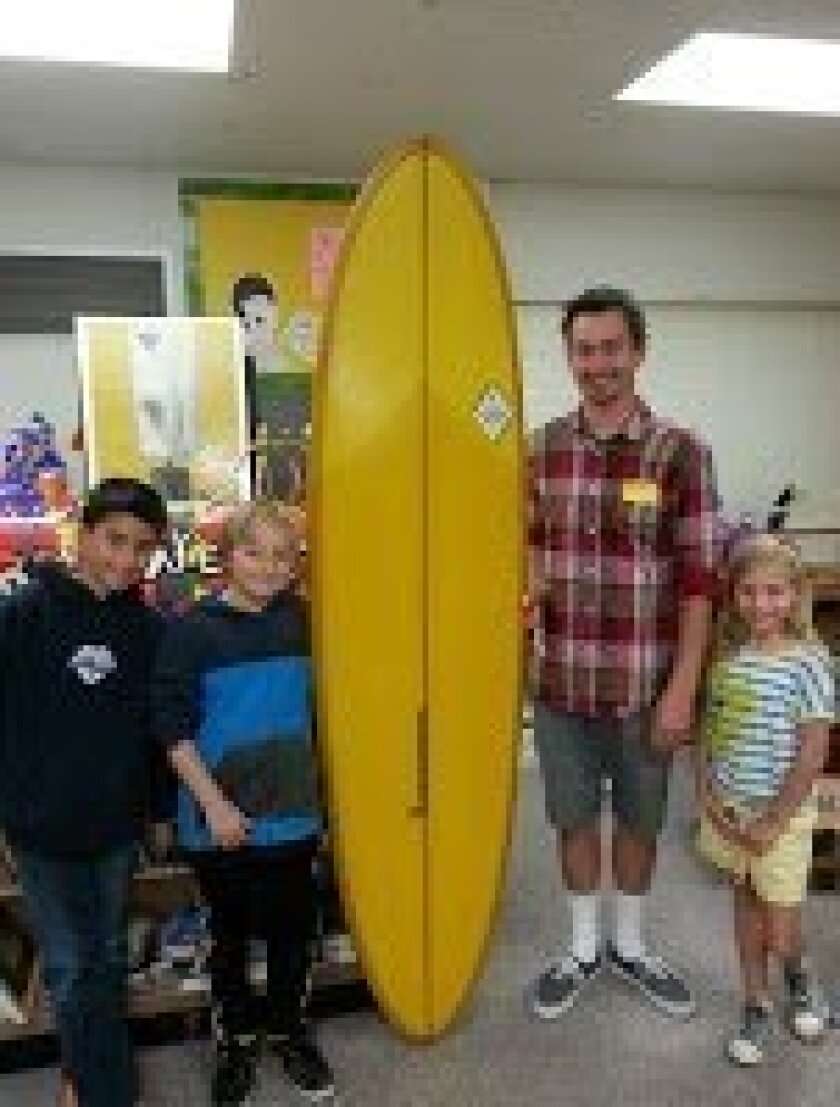 Local surfboard designer Josh Oldenburg (at right with students) paid a visit to the fourth grade classes of Del Mar Heights Elementary as part of the school's ongoing ArtPartners program.