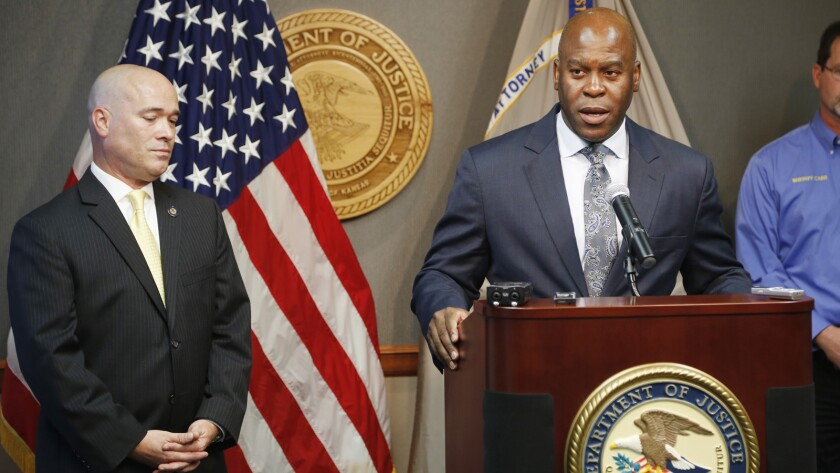 FBI Special Agent in Charge Eric Jackson talks about the agency's role in stopping a bomb plot as he joined Acting U.S. Attorney Tom Beall, left, in announcing charges in a suspected domestic terrorism plot, in Wichita, Kansas.