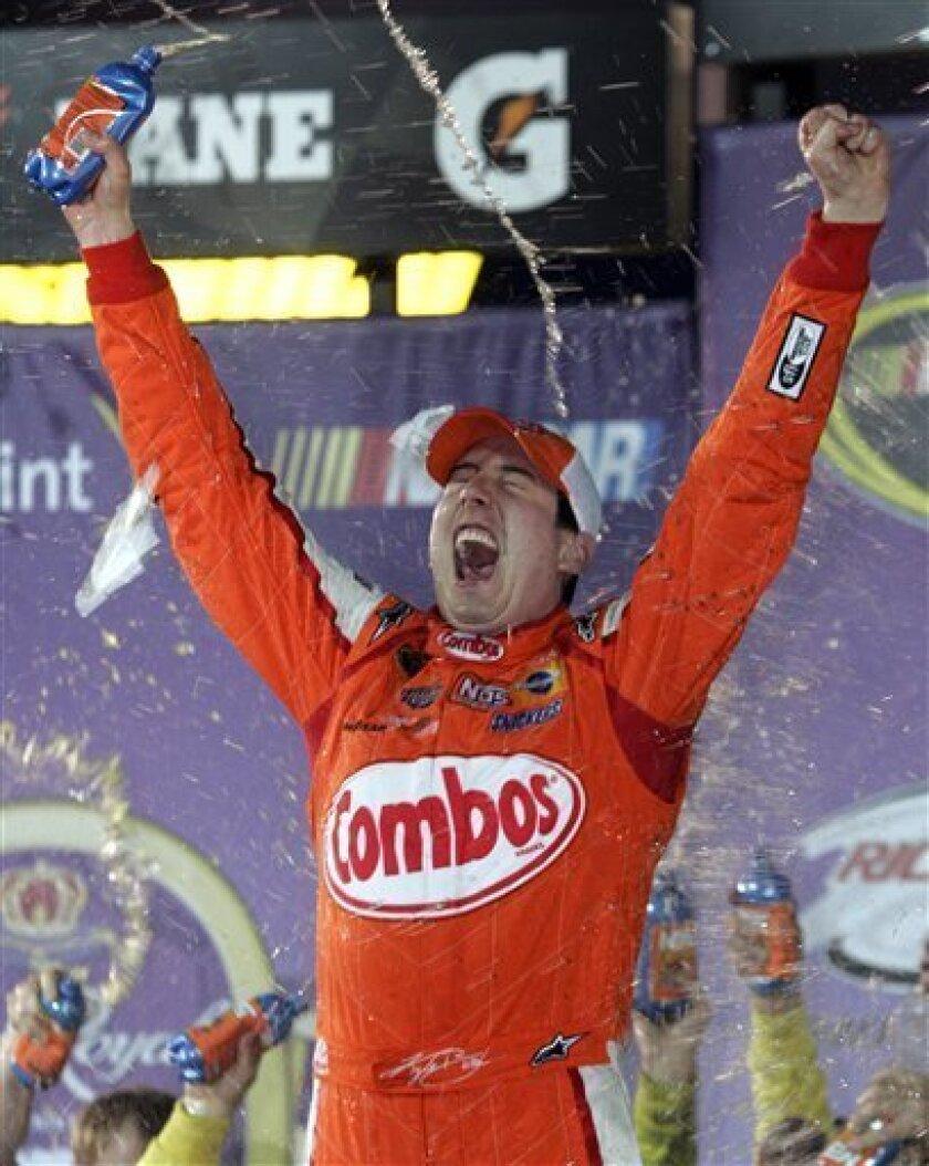 Kyle Busch celebrates winning the the Crown Royal 400 Sprint Cup Series NASCAR race on his birthday at Richmond International Raceway in Richmond, Va., Saturday, May 2, 2009. (AP Photo/Steve Helber)