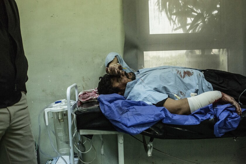 A man wounded Thursday in a car bomb attack in Mosul, Iraq, waits for treatment at a hospital in Irbil.