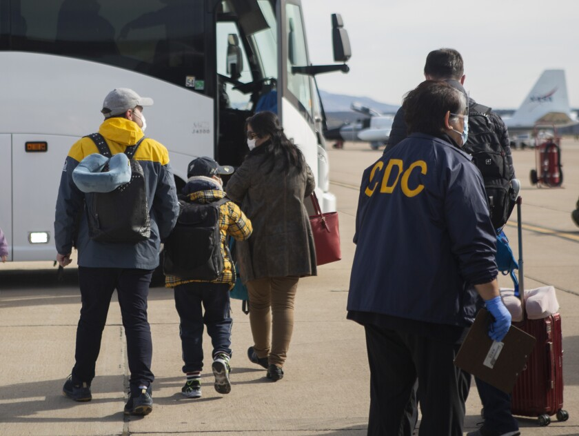 FILE - This Wednesday, Feb. 5, 2020, file photo provided by the U.S. Department of Health and Human Services shows evacuees from China arriving at Marine Corps Air Station in Miramar, Calif. An evacuee from China has tested positive for the coronavirus and has been isolated at a San Diego hospital, a person with direct knowledge of the matter tells The Associated Press, Monday, Feb. 10, 2020. (Krysten I. Houk/U.S. Department of Health and Human Services via AP, File)