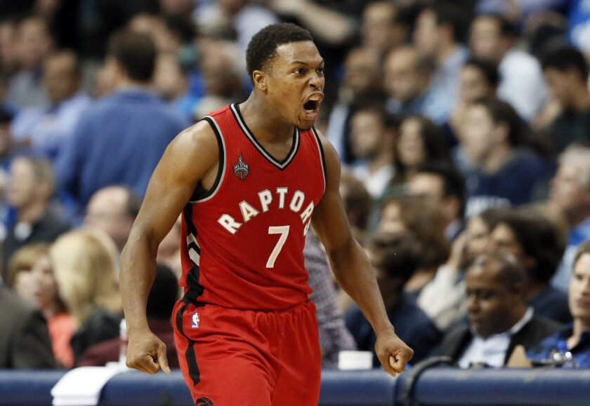Toronto Raptors guard Kyle Lowry (7) celebrates scoring a basket against the Dallas Mavericks late in the second half of an NBA basketball game Tuesday, Nov. 3, 2015, in Dallas. Lowry lead all scoring with 27-points in the 102-91 Raptors win. (AP Photo/Tony Gutierrez)