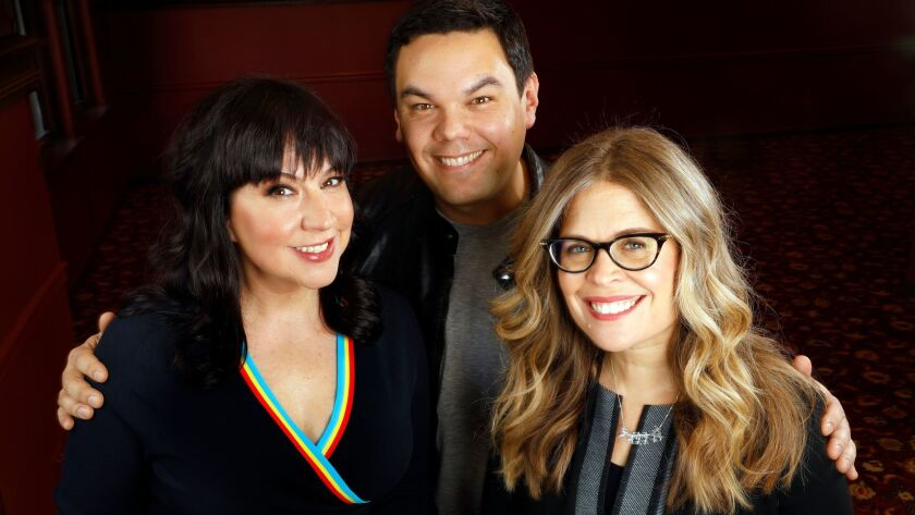 """""""Frozen"""" songwriters Kristen Anderson-Lopez, left, and Bobby Lopez, and book writer Jennifer Lee."""