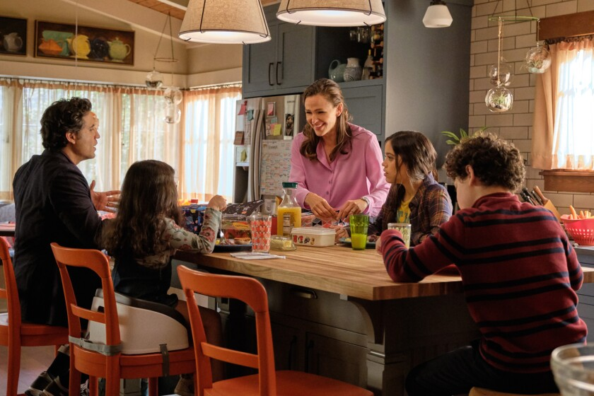 "Edgar Ramírez, left, Everly Carganilla, Jennifer Garner, Jenna Ortega and Julia Lerner in at the dinner table in ""Yes Day."""