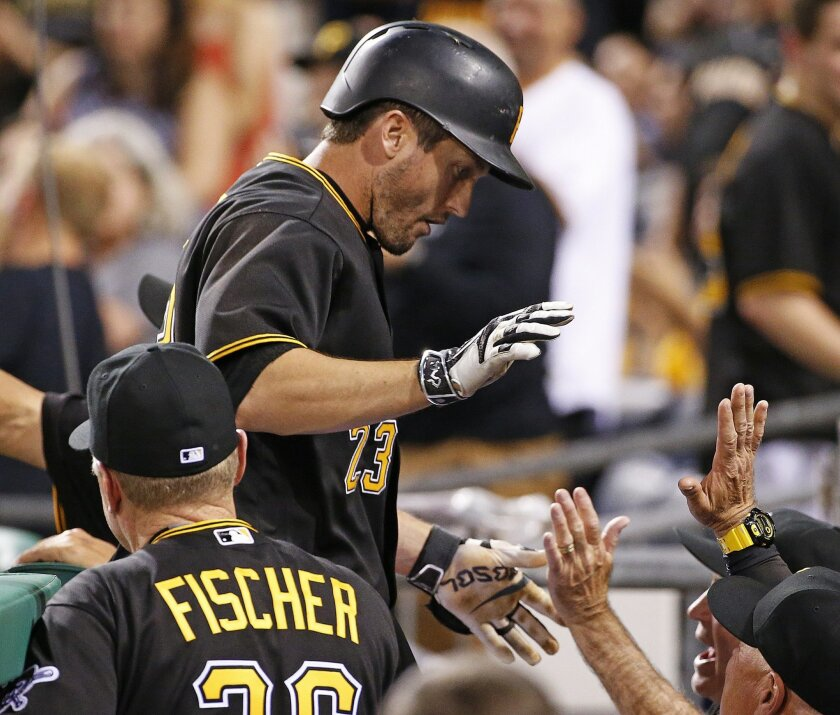 Pittsburgh Pirates' David Freese (23) returns to the dugout after hitting a two-run home run off Arizona Diamondbacks starting pitcher Rubby De La Rosa during the fifth inning of a baseball game in Pittsburgh, Wednesday, May 25, 2016. (AP Photo/Gene J. Puskar)