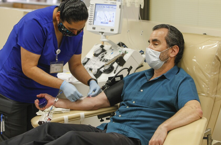 Dan Galant makes a plasma donation at the San Diego Blood Bank on May 6.