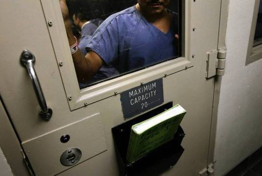 An immigrant in a holding cell at a U.S. Immigration and Customs Enforcement detention facility in Arizona.