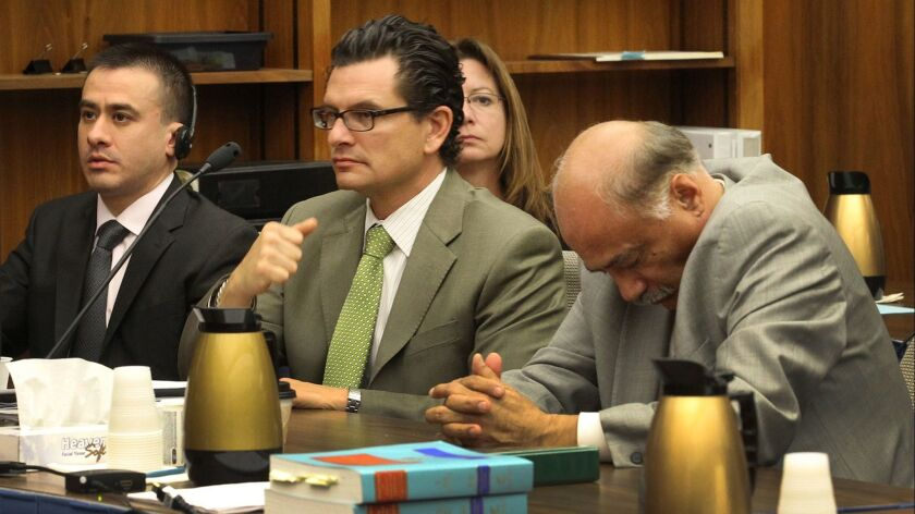 Jorge Rojas Lopez and his defense attorneys Dan Mangarin, right, and Ricardo Garcia center, listened as judge David Rubin read the verdicts against Rojas on Thursday, January 16, 2014.