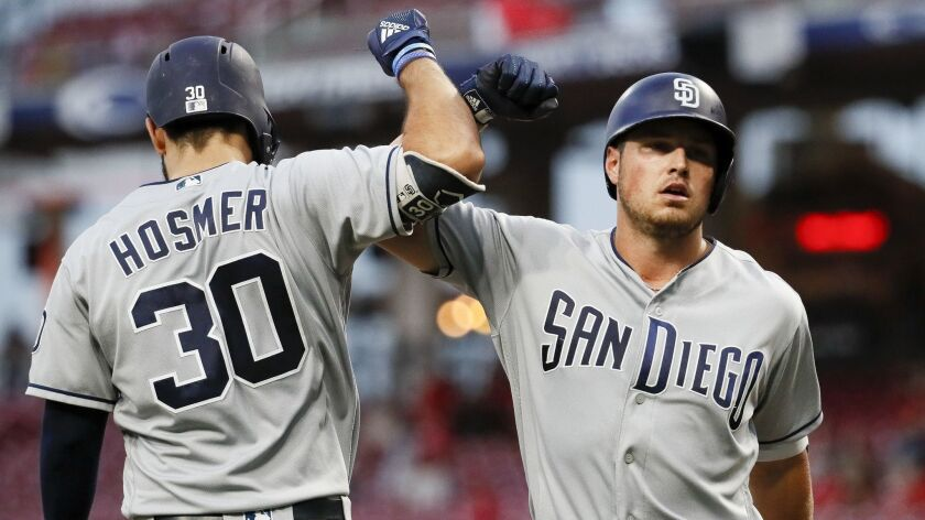 Hunter Renfroe, right, celebrates with Eric Hosmer after hitting a solo home run in the fourth inning Thursday in Cincinnati.
