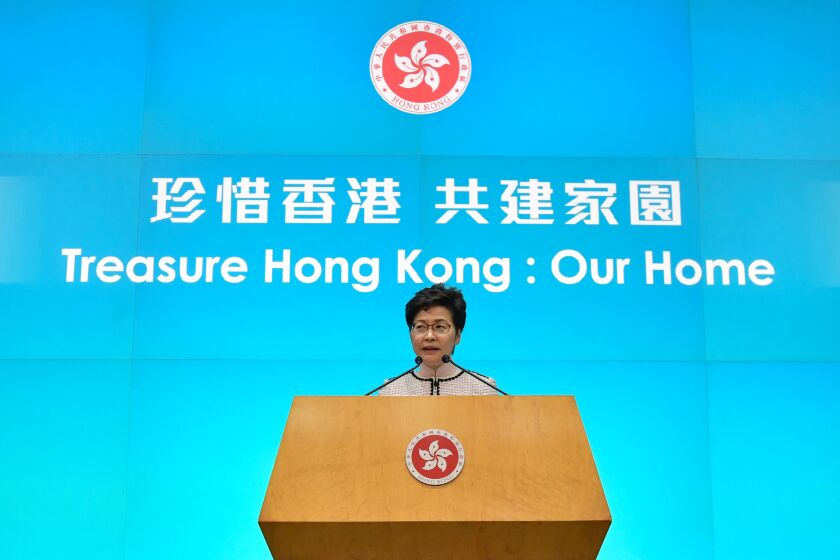 Hong Kong leader tries to deliver annual policy address on live TV, forced to switch to video