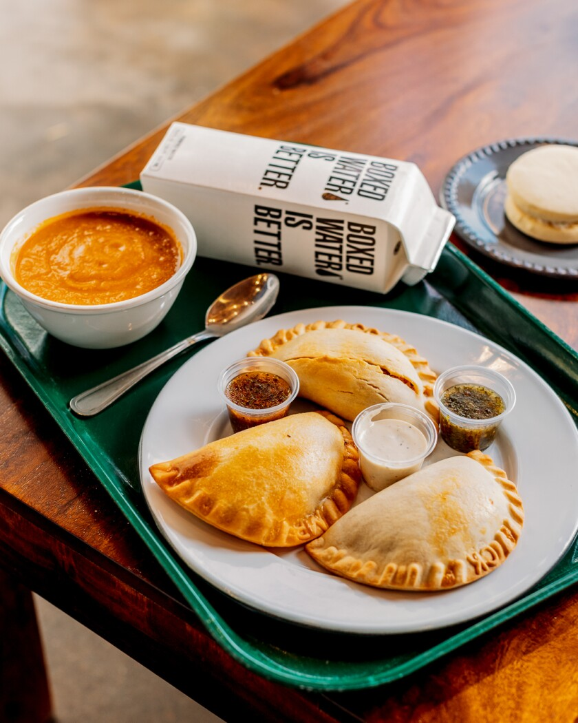 The lunch combo includes three empanadas, a drink and side of soup or salad