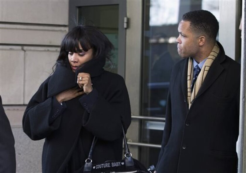 FILE - This Feb. 20, 2013 file photo, former Illinois Rep. Jesse Jackson Jr. and his wife Sandi leave federal court in Washington. On Tuesday, July 2, 2013, U.S. District Judge Amy Berman Jackson set a new sentencing date of Aug. 14 for Jackson and his wife. Jackson pleaded guilty this year to spending $750,000 in campaign funds on personal items, including mounted elk heads and a gold-plated Rolex watch. His wife, former Chicago alderman Sandi Jackson, pleaded guilty to filing false joint tax r