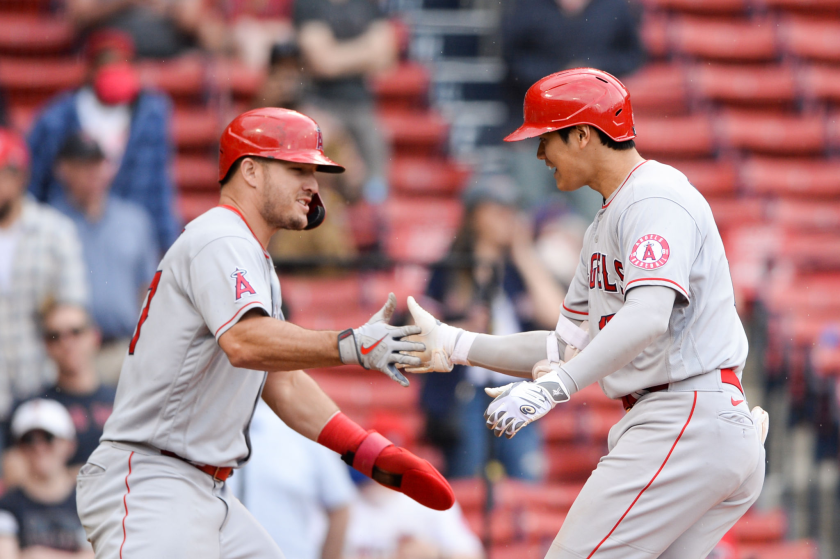 The Angels' Shohei Ohtani celebrates with teammate Mike Trout.
