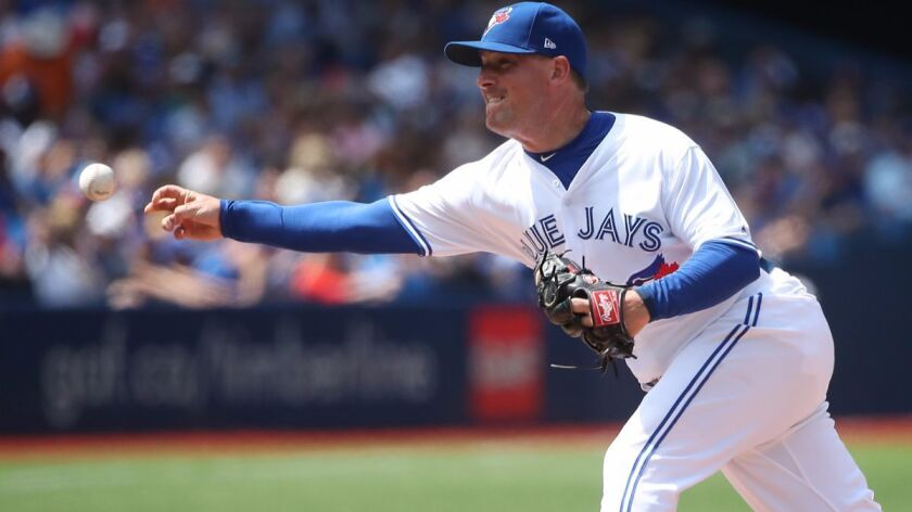 Joe Smith delivers a pitch in the seventh inning during a game between the Toronto Blue Jays and the Oakland Athletics on Thursday. The Blue Jays traded Smith to the Cleveland Indians on Monday.