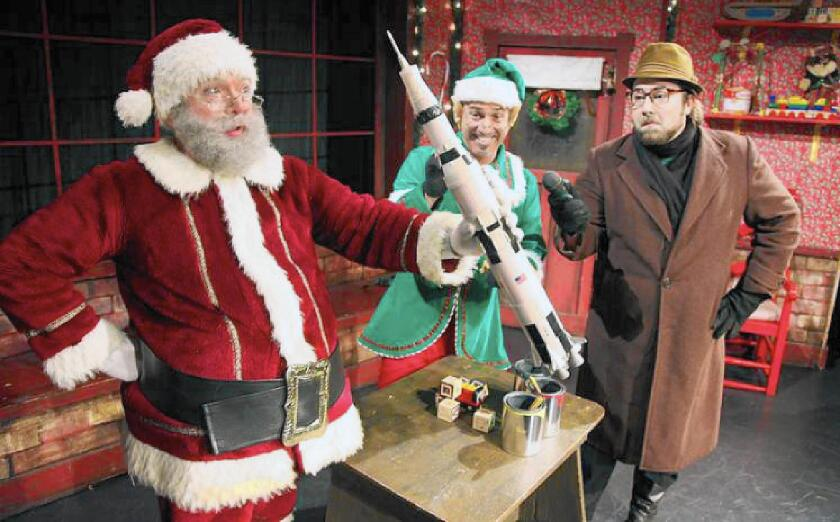 """Spencer Douglas, Donny Vanhorn and Ryan Young in a scene from """"Santa Claus Conquers the Martians"""" at Fullerton's Maverick Theater."""