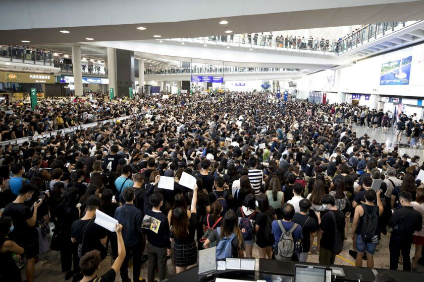 Protesters demonstrate at the airport in Hong Kong on Monday.