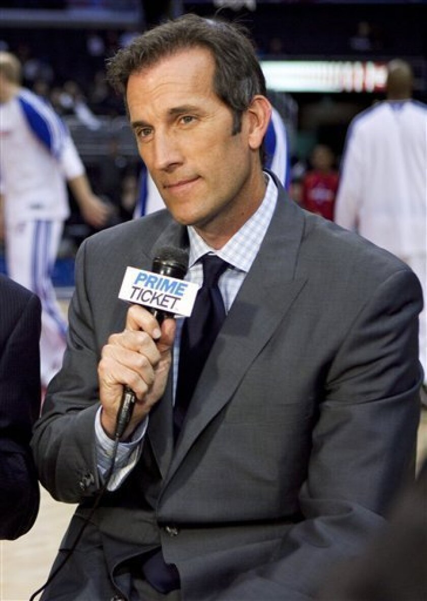 File - In this Nov.23, 2009, file photo, Los Angeles Clippers announcer Michael Smith appears during a pregame show before an NBA basketball game in Los Angeles. Smith was charged with stealing $735,000 from a golfing buddy in a development deal gone bad. (AP Photo/Jeff Lewis,file)