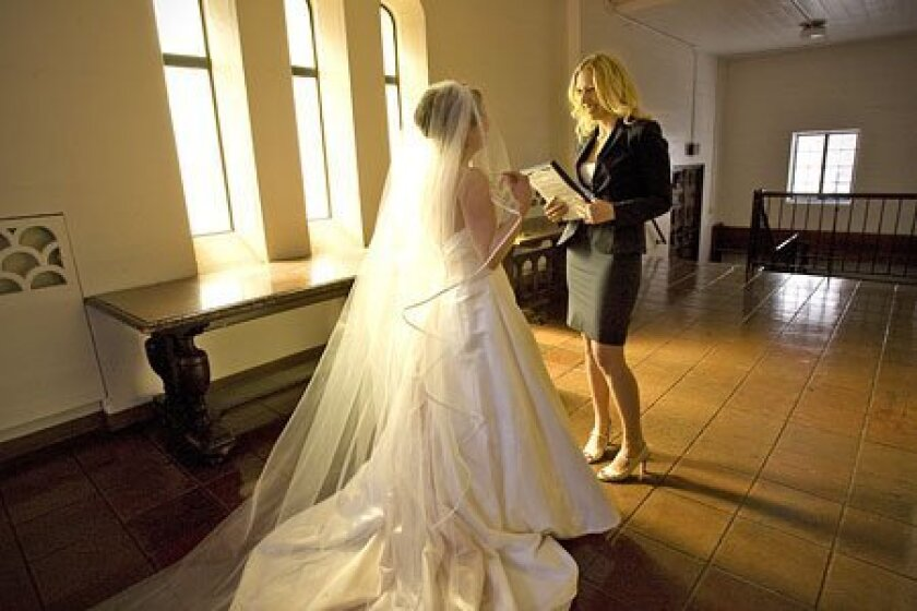 With a hectic job, Heather Hendren considered wedding coordinator Cynthia Zatkin an essential expense. (Nelvin C. Cepeda / Union-Tribune)