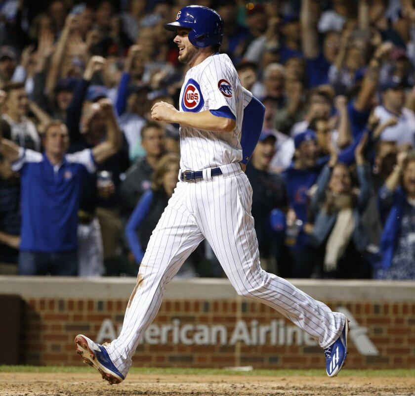 FILE - In this Sept. 1, 2016, file photo, Chicago Cubs' Kris Bryant scores on a single by Addison Russell during the seventh inning of a baseball game against the San Francisco Giants,  in Chicago. Bryant is batting .305 with 36 homers and a major league-best 112 runs scored, and he wants more. He